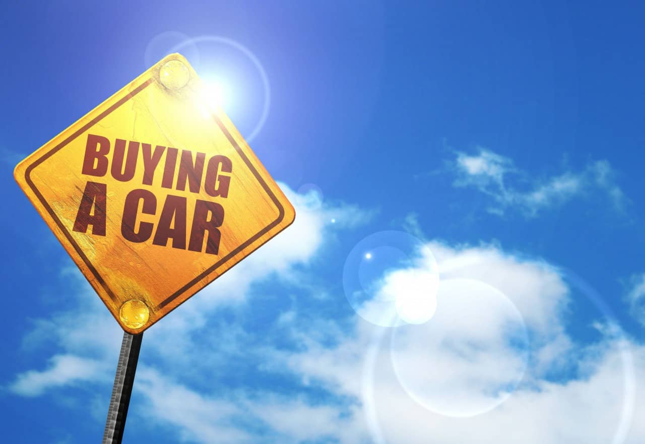 buying a car road sign